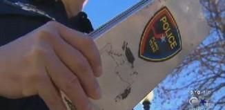 Police issue ticket - CBS video snapshot