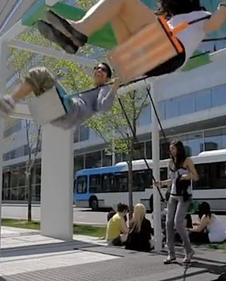 swings at an Montreal bus stop