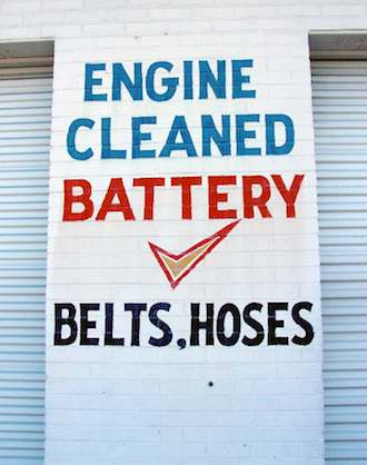 Car garage sign - Engines cleaned by DHester via Morguefile