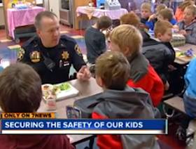 deputy sits at school lunchtable - ABC Video