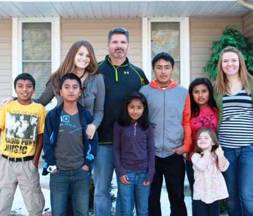 family with 5 Peruvian adopted kids