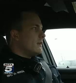 policeman in patrol car KCTV video