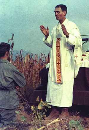 Catholic Army Chaplain holds mass in field