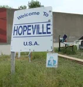 Hopeville welcome sign-InvisiblePeople-video