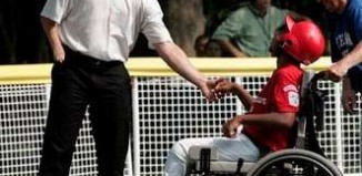 Jim Abbott greets wheelchair athletics fan