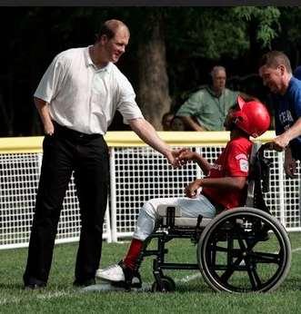 Jim Abbott greets wheelchair athletics fan