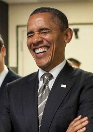 Obama laughing - photo by Pete Souza, WH
