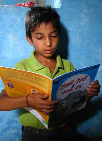 boy reads in Nepal - Room to Read photo