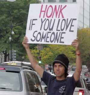 Love Someone and honk sign