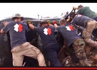 Team Rubicon lifting car