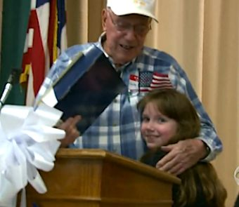 elderly vet gets medals from 8yo