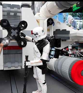 storm trooper wth life-sized X-Wing fighter