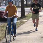 bicycle riding senior with runner on sidewalk-RatRodBikes