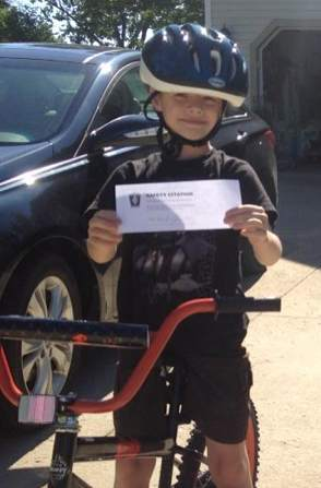 helmeted boy Brimfield Police FBPage