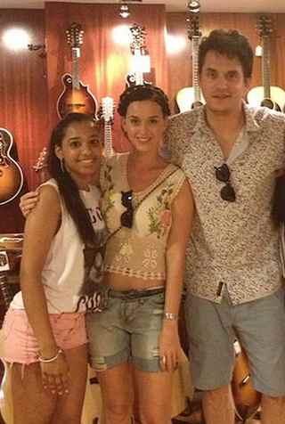 John Mayer in guitar shop w fan and Katy Perry