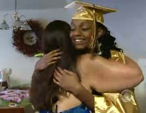 graduate hugged by foster mom-CBSVid