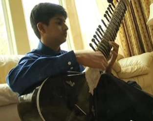 sitar playing boy aces SAT-KGOvid