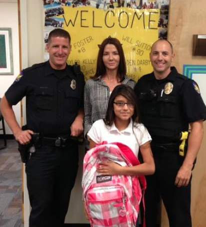 Policemen with school girl and new backpack-PPD