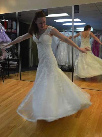 bride tries on dress-familyphoto