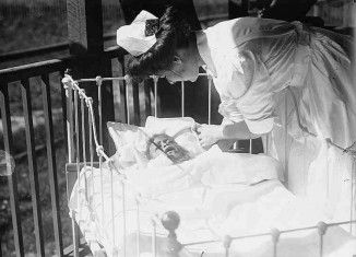 nurse and baby - Photo by Library Of Congress