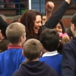 woman cheers amid schoolkids (video screenshot)