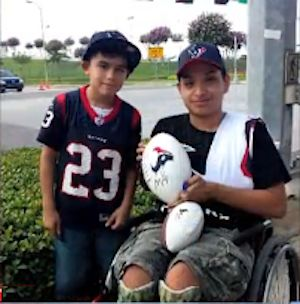 football autograph given to wheelchair-bound boy, family photo