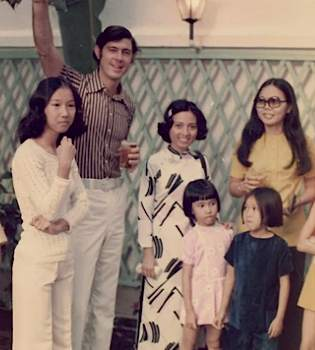 60s banker with Vietnamese staff - family photo