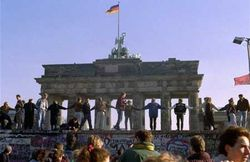 Germans dancing at the Brandenburg Gate after the fall of the Berlin Wall.