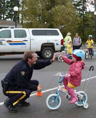 Police in Canada high five kids on bikes