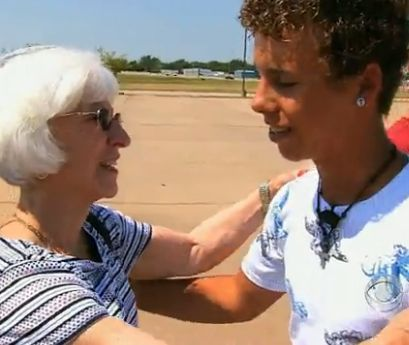 elderly woman embraces teen-CBSvid