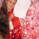 Christmas child with letter and tree-Emmileah Anderson