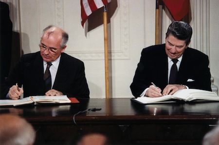 Reagan and Gorbachev signing treaty - WH photo