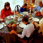 Thanksgiving table family says grace Unknown-origin