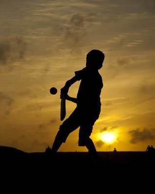 cricket-playing boy-Photosightfaces-flickr-CC