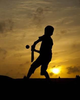 cricket-playing boy-Photosightfaces-flickr-CC
