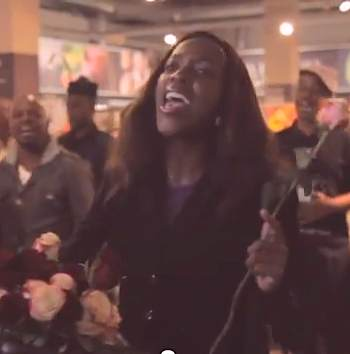 Black singer in flashmob-SowetoGospelChoir