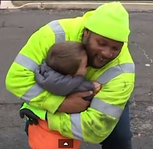 trash man hugs boy