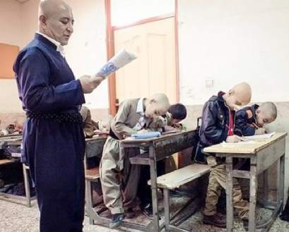 Iran teacher shaves head for pupil-Bahman Shahbazi for Tasnim