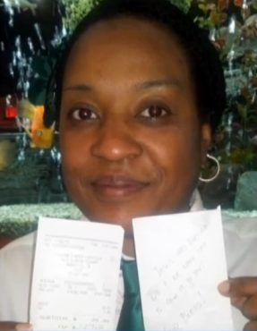 waitress holds tip receipt for thousand dollars