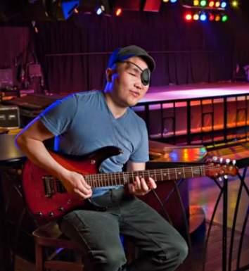 Gabriel Hurley w guitar-RutgersToday