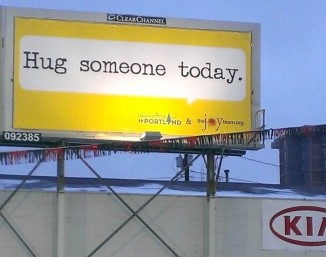 Hug someone today billboard The JoyTeam