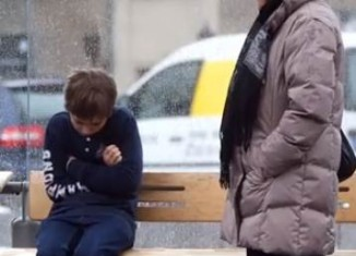 boy shivering on bench lady stands-YouTube