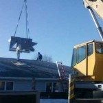 crane-lowers furnace at humane society