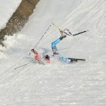 skiier falls in Olympic x-Country event