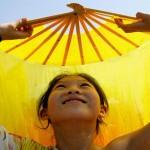 Chinese girl dances with fan -Giacomo Pirozzi/UNICEF