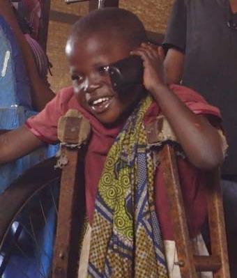 telephone African boy talks to mom