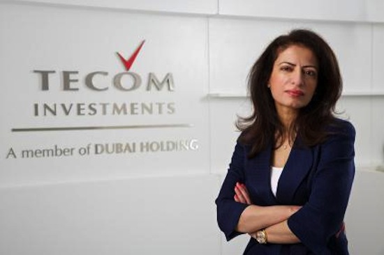 Arab_woman_in_boardroom-Amina_al-Rustamani-Telcom-Investments