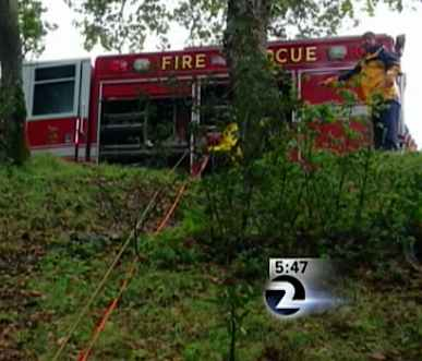 Rescue trucks ropes down ravine-KTVU