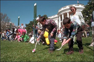 Kids race to push Easter eggs with spoons on White House lawn.