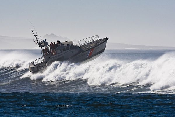 boat_in_California_surf-Coast_Guard-Flickr-CC-mikebaird